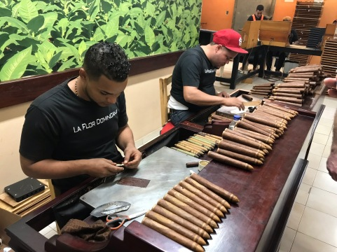 LFD cigar makers use a scalpel to shape signature designs for specially-made cigars like those with a football sold in the weeks before the Super Bowl.